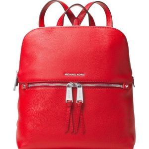 c2339b901be4 Michael Kors Bags - Michael Kors Red Rhea medium slim leather backpack